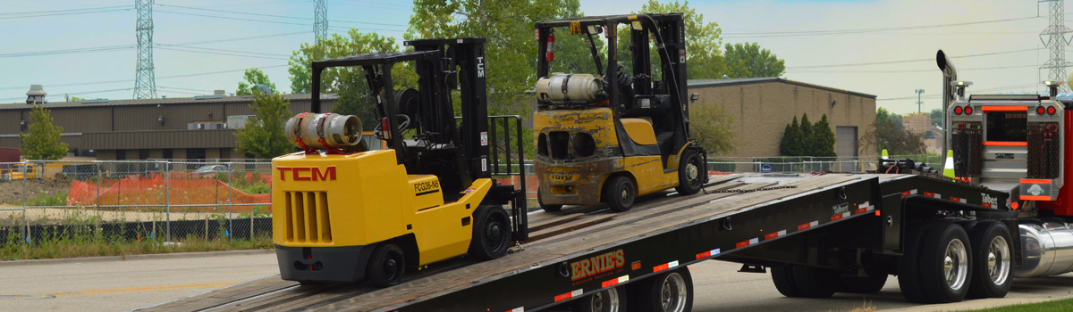 A forklift being transported from a forklift dealer.