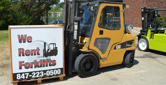 A forklift rental holding a forklift rental sign.