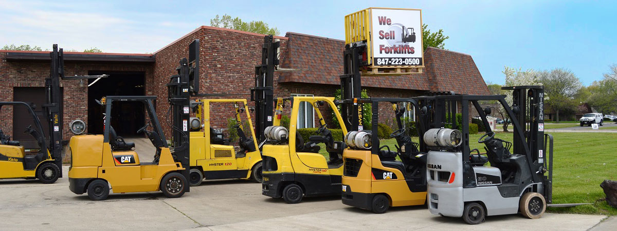 A group of used forklifts for sale.